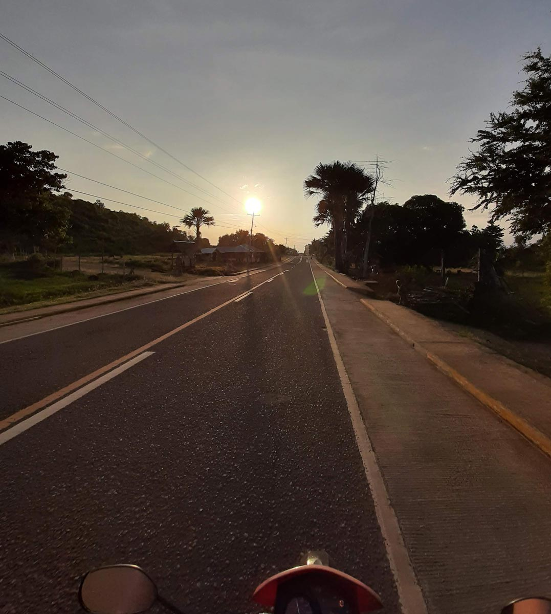 Riding into the sunset in Siquijor on a motorcycle